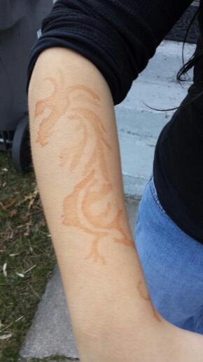 Fake henna tattoo of a dragon.