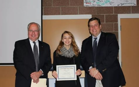 "(from left to right) President of LCSC; Dr. J. Anthony Fernandez, Ashley Smith holding her ""Silver Club"" certificate, and Vice President of Student Affairs; Andrew T. Hanson, Ph.D."