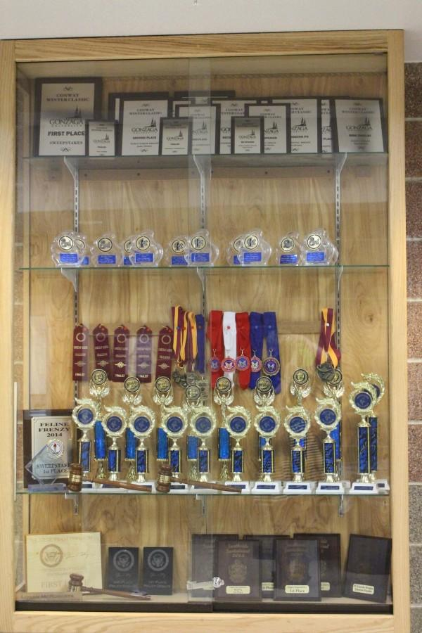 The+trophy+case+outside+of+the+debate+room+houses+all+of+the+trophies+that+the+debate+kids+have+won.