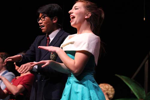 """At the high school hop, Eugene and Patty (Malachi Tran and Brittney Ellenbecker) dance to the song """"Born To Hand Jive"""" in the school dance competition."""