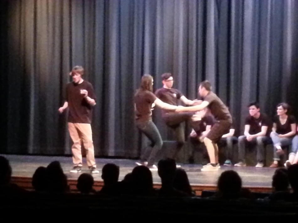 Improv team with Oskar Owens, Piper Glover, Apollo Rose, and Kody Kratz in the front.