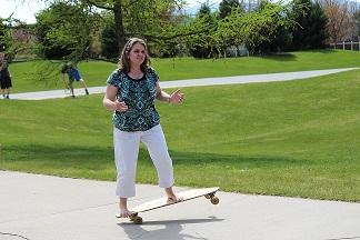 Mrs. Reed skateboarding during a class period spent outside prepping for the kickball tournament.