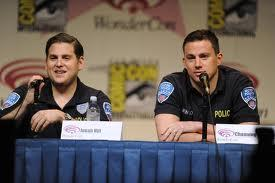 Jonah Hill (left) and Channing Tatum (right) doing an interview dressed as their  characters.
