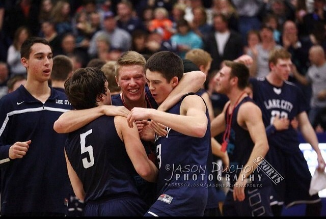 This picture shows the boys varsity team last year in celebrating the win against Coeur d' Alene High School