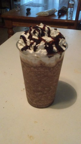 Homemade chocolate chocolate chip blended coffee with whipped cream.