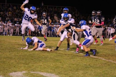 Cameron Chun being tackled at the 40yd line